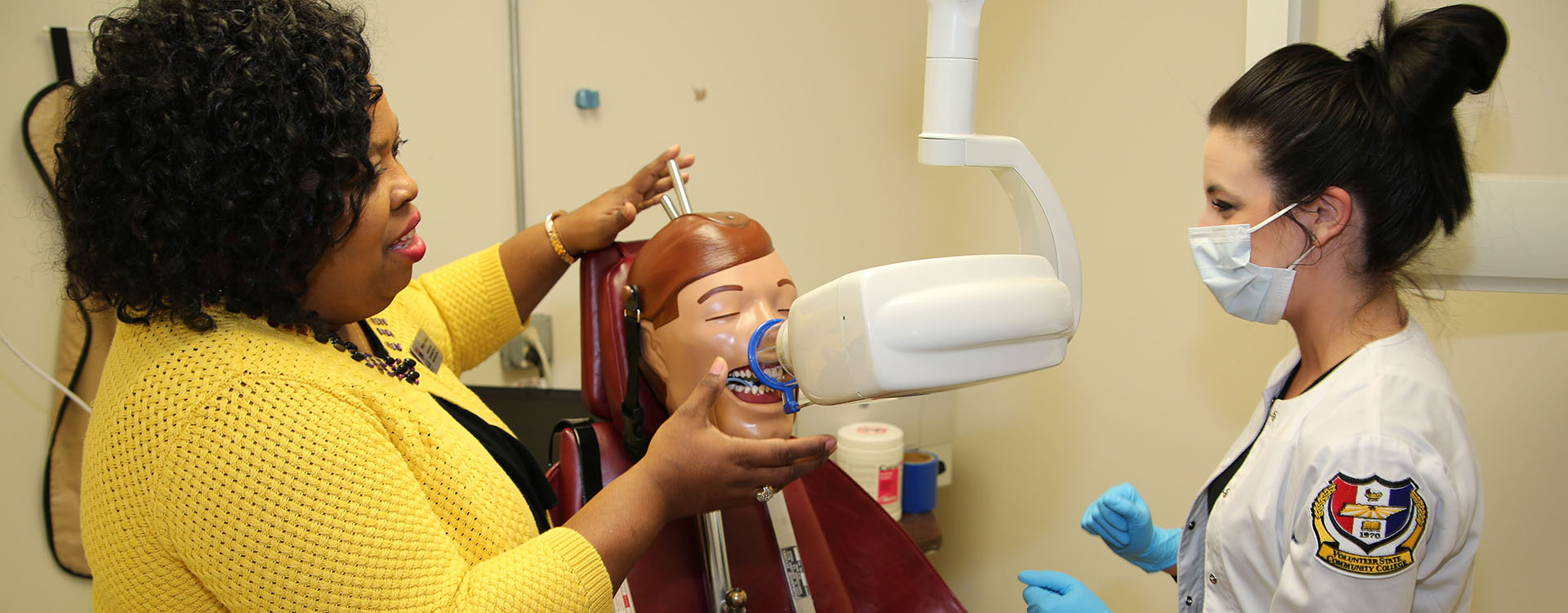 dental assisting student learning from teacher