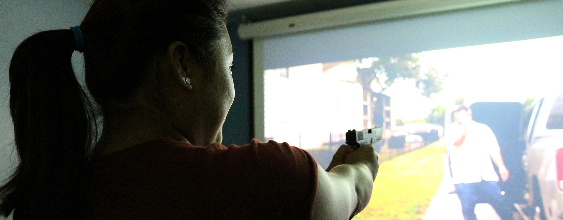student participating in a shooting simulator