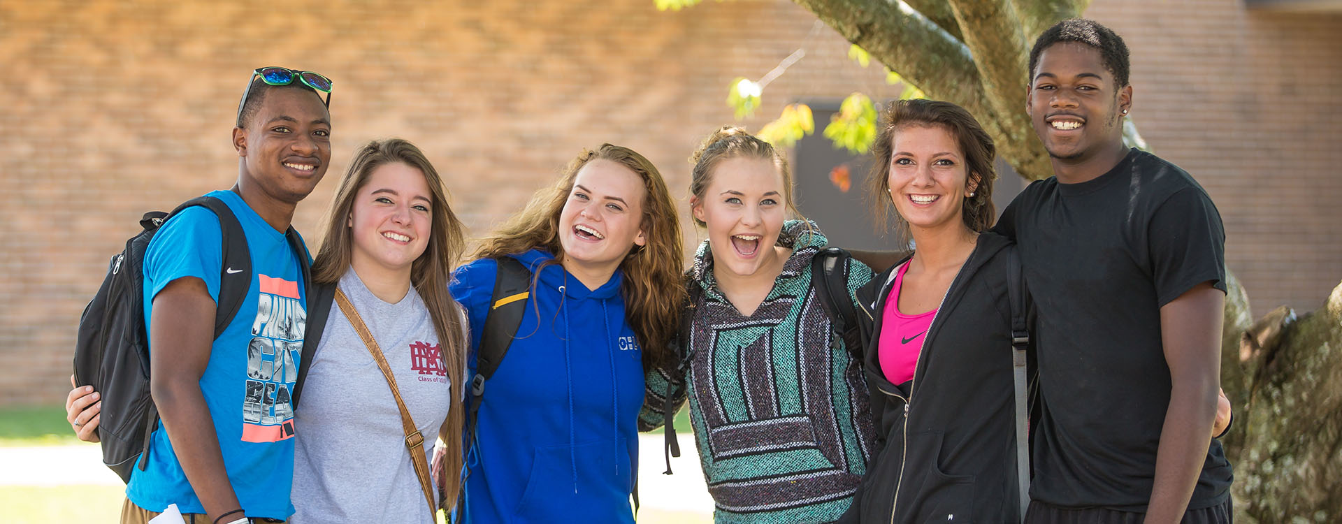 group of students smiling on campus