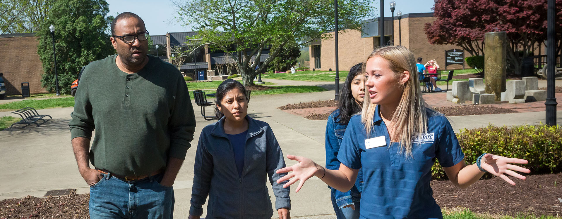 a campus tour guide leading a group
