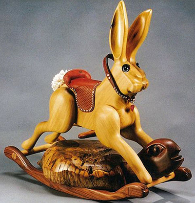 Russ Jacobsohn art: wood carving of the tortios and the hare