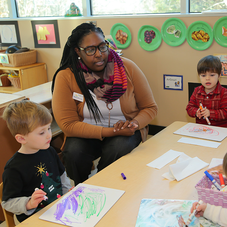 teacher working with preschool students