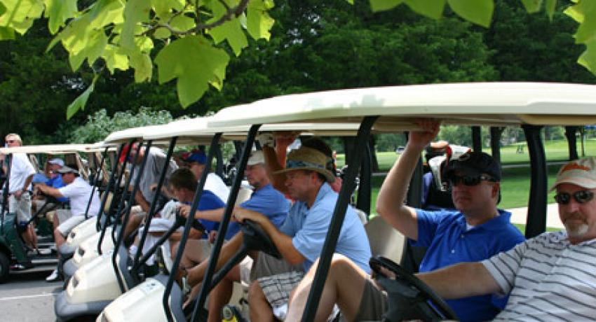 participants sitting in golf carts