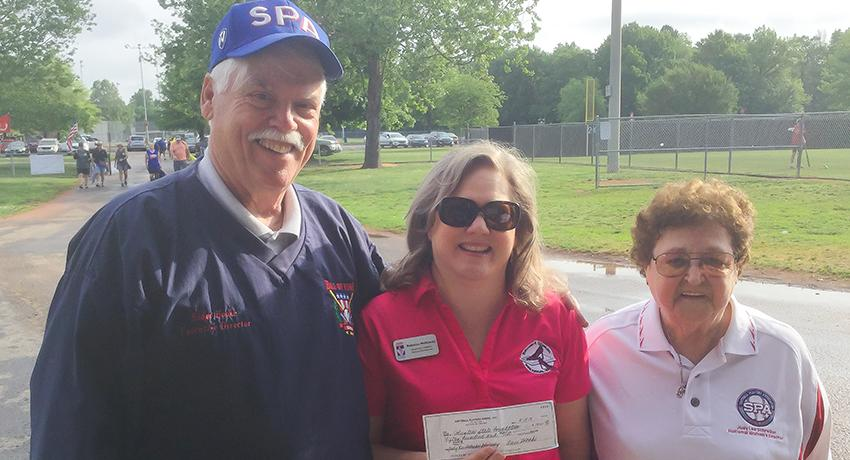 Softball Players Association check presentation