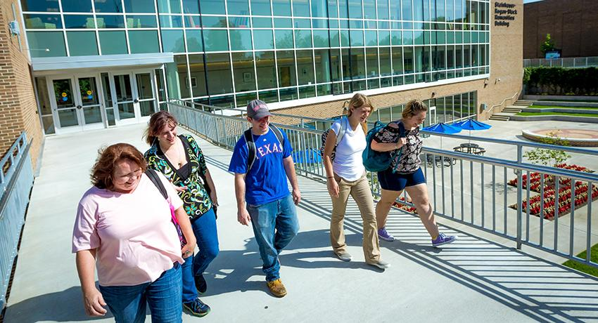 Vol State students walk across a bridge on the Gallatin campus.