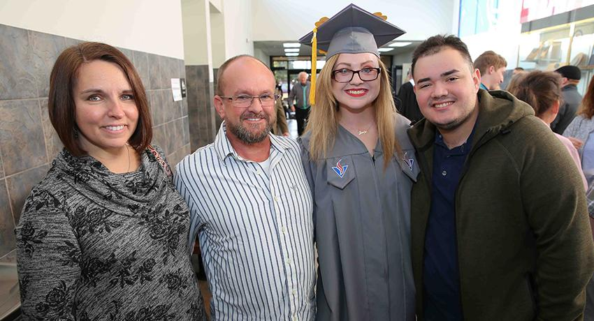 Graduate Meaghan Brewington of Westmoreland was joined by well-wishers Jennifer Copeland, Bernie Copeland, and Joseph Pinchevsky.