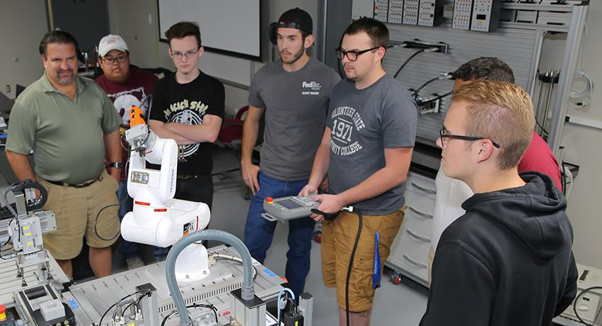 Vol State Mechatronics students work on a robotic arm assembly in the lab on the Gallatin campus.