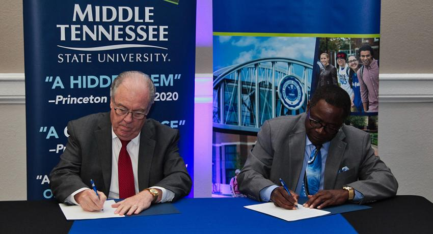 MTSU President Sidney A. McPhee and Vol State President Jerry Faulkner signed the documents