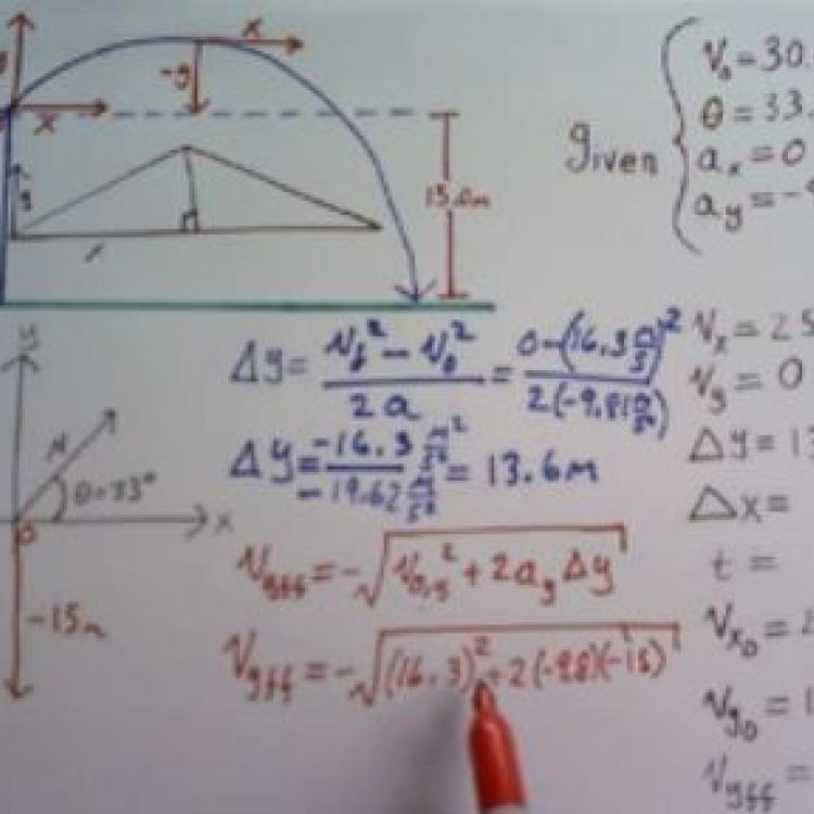Physics problem written on a whiteboard