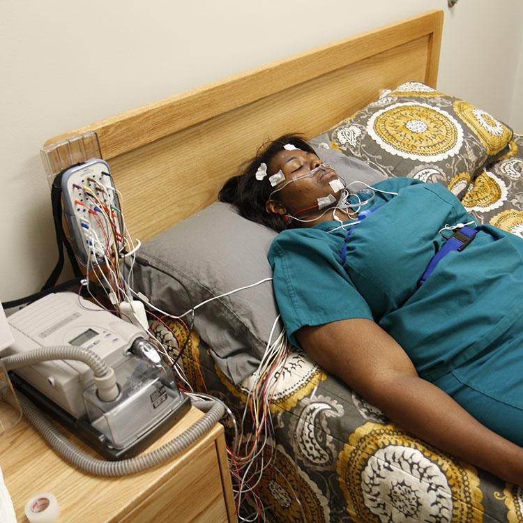 woman sleeping while wearing diagnostic equipment