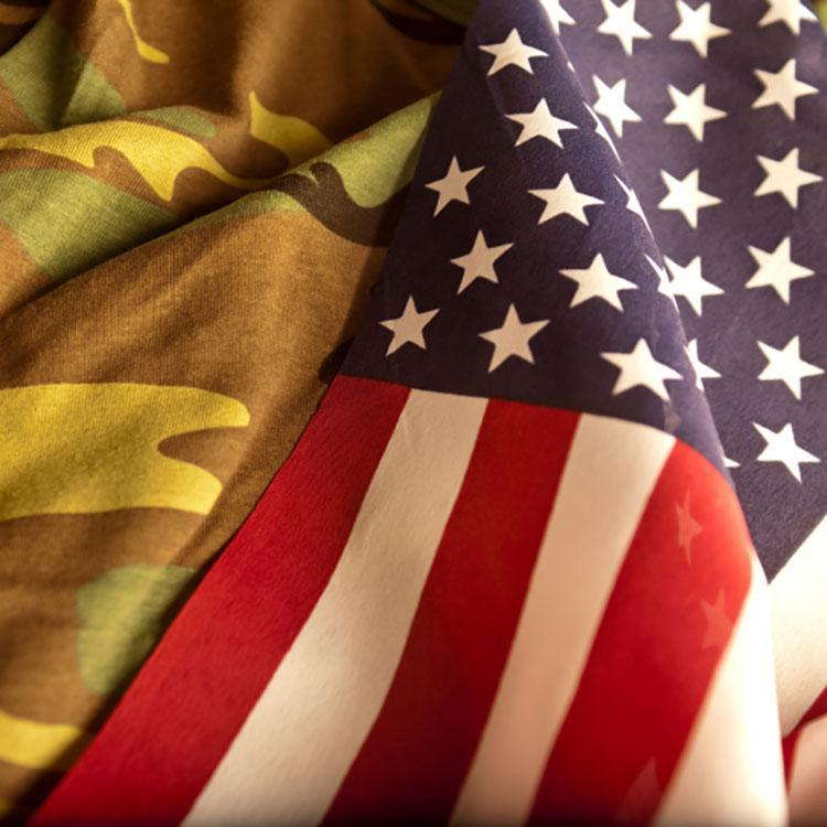 US flag beside a camouflage uniform