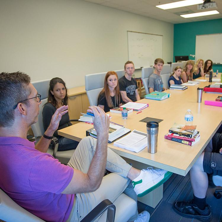 students participating in a roundtable discussion